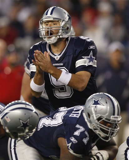 Dallas Cowboys quarterback Tony Romo communicates with his offensive squad on the line of scrimmage. (AP Photo/Charles Krupa)