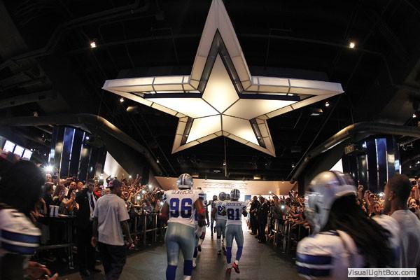 Dallas Cowboys walk through the tunnel at Cowboys Stadium in Arlington, TX