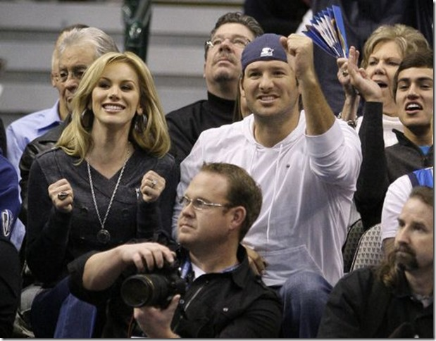 COWBOYS QB TONY ROMO AND WIFE CANDICE CRAWFORD: Dallas Cowboys quarterback Tony Romo (right) reacts to a shot by the Dallas Mavericks as he and his fiancee, Candice Crawford take in the Mavericks' NBA basketball game against the Los Angeles Lakers on Wednesday, Jan. 19, 2011, in Dallas. The Mavericks won the game, 109-100.