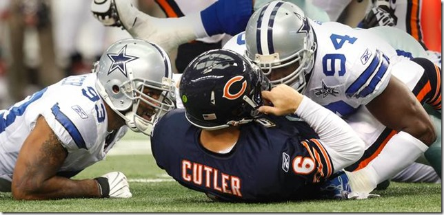 DeMarcus Ware and Anthony Spencer introduce themselves to Chicago QB Jay Cutler