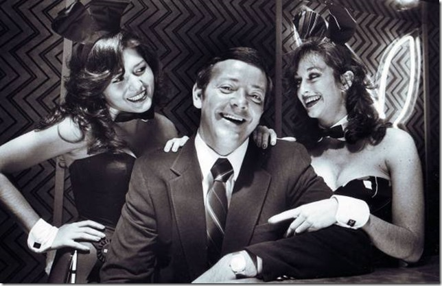 BUNNY CLUB OWNER - Dallas Playboy Club owner Carroll Davis (center) at the club with playmates Debbie Gonzales (left) and Elaine Oxman (right) on September 28, 1981.