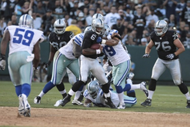 Dallas Cowboys DE Ben Bass (79) grabs Oakland Raiders QB Terrelle Pryor - The Boys Are Back blog
