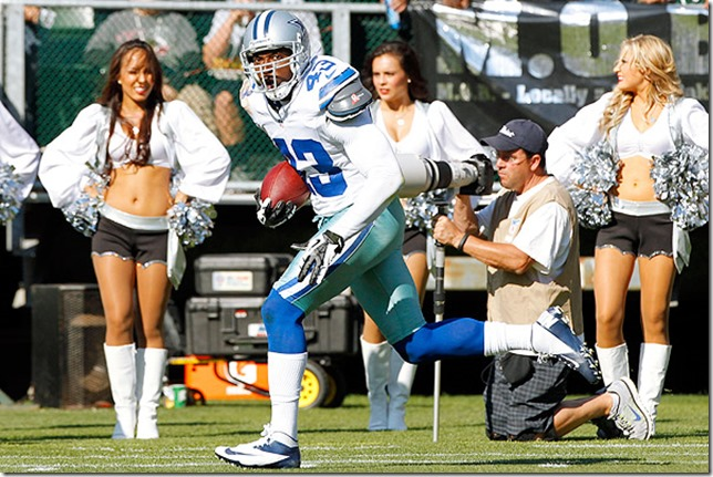 August 13, 2012; Oakland, CA, USA; Dallas Cowboys defensive back Gerald Sensabaugh (43) runs with the ball after intercepting a pass against the Oakland Raiders in the first quarter at O.Co Coliseum. Mandatory Credit: Cary Edmondson-US PRESSWIRE