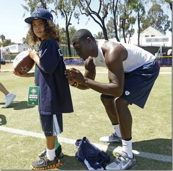 Morris Moore, 8, of Los Angeles gets an autograph from Dallas Cowboys cornerback Morris Claiborne - The Boys Are Back blog