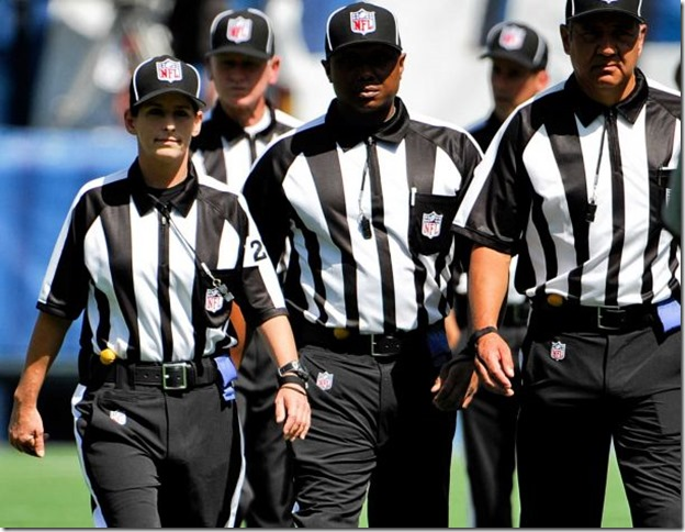 PHOTO: Line judge Shannon Eastin, left, takes the field prior to an NFL preseason football game between the San Diego Chargers and the Green Bay Packers, Thursday, Aug. 9, 2012, in San Diego. Eastin is a replacement line judge who will make her NFL debut in the exhibition game. The regular officials are locked out by the league after their contract expired. Photo: Denis Poroy / AP - The Boys Are Back blog
