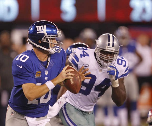 Dallas Cowboys linebacker DeMarcus Ware (94) pursues New York Giants quarterback Eli Manning - The Boys Are Back blog