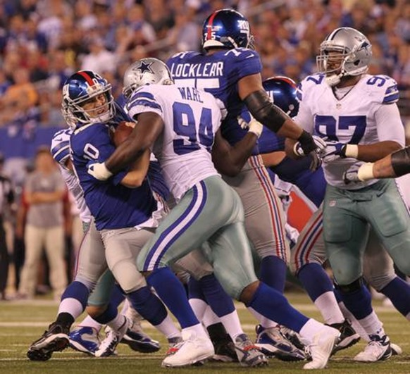 Dallas Cowboys linebacker DeMarcus Ware (94) sacks New York Giants quarterback Eli Manning in second quarter - The Boys Are Back blog
