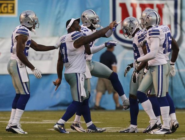 Dallas Cowboys players congratulate defensive back Brandon Carr (39) after his second interception against the San Diego Chargers - The Boys Are Back blog