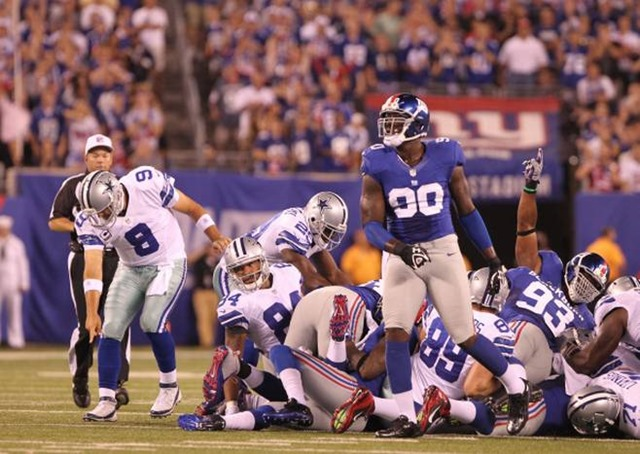 Dallas Cowboys quarterback Tony Romo (9) notes to the officials the spot of the ball after a short rush - The Boys Are Back blog