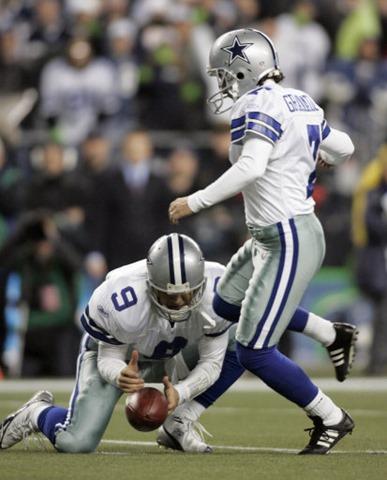 Dallas Cowboys Tony Romo bobbles the snap - The Boys Are Back blog