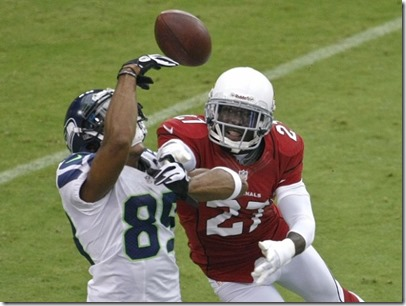 Doug Baldwin misses a pass from QB Russell Wilson as Cardinals DB Michael Adams breaks up the play during the first half Sunday. (Rick Scuteri AP Photo) - The Boys Are Back blog