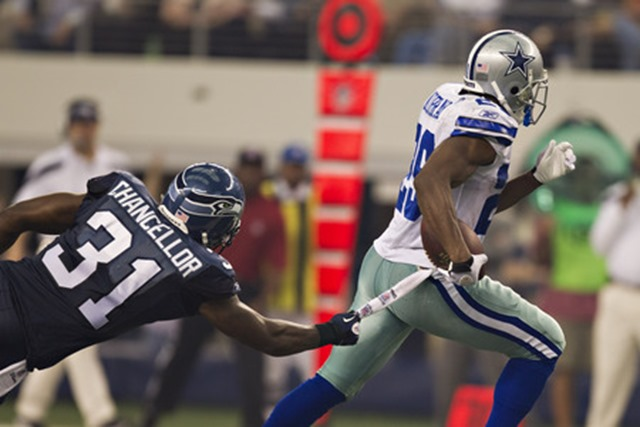 Kam Chancellor #31 of the Seattle Seahawks reaches out to tackle DeMarco Murray