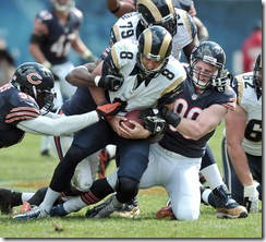 Rookie Shea McClellin and other Bears bring down Rams QB Sam Bradford in the third quarter, one of six sacks by the team. Courtesy - Tom Cruze Chicago Sun-Times - The Boys Are Back blog