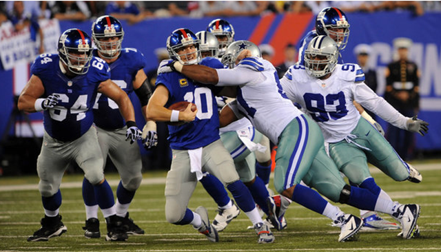 The Giants' Eli Manning being sacked by the Cowboys in the fourth quarter - The Boys Are Back blog