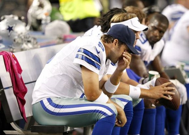 Dallas Cowboys quarterback Tony Romo (9) dejected on the bench - The Boys Are Back blog