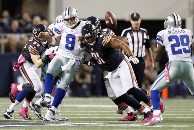 Dallas Cowboys quarterback Tony Romo (9) is hit by Chicago Bears defensive tackle Amobi Okoye (91) after making a shovel pass to Dallas Cowboys running back DeMarco Murray - The Boys Are Back blog