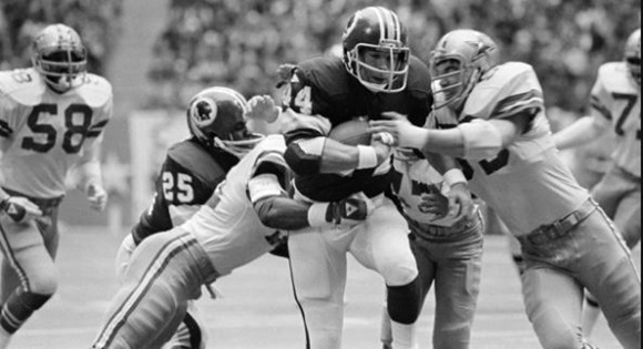 Dec. 16, 1979 - Fullback John Riggins (44) is slowed down near the Dallas goal line by Cowboys cornerback Benny Barnes, left, and linebacker Bob Breunig - The Boys Are Back blog