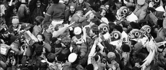 Jan. 22, 1983 - Washington Redskins coach Joe Gibbs, center, is in the crush with members of his team after they beat the Dallas Cowboys for the NFC Championship at RFK Stadium - The Boys Are Back blog
