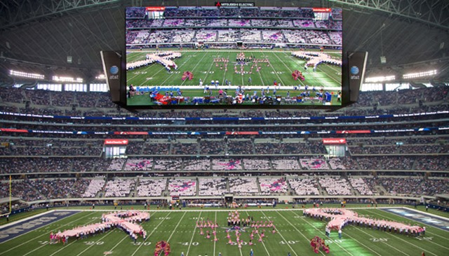 The group, totaling 500, came together to form two human pink awareness ribbons at halftime on Monday Night Football - The Boys Are Back blog