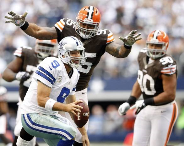 Cleveland Browns defensive end Juqua Parker (95) pressures Dallas Cowboys quarterback Tony Romo - The Boys Are Back blog