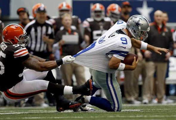 Cleveland Browns defensive end Juqua Parker pulls down Dallas Cowboys quarterback Tony Romo - The Boys Are Back blog