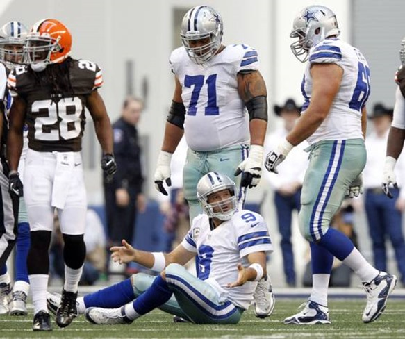 Dallas Cowboys quarterback Tony Romo (9) looks up at Dallas Cowboys tackle Doug Free (68) after getting sacked - The Boys Are Back blog