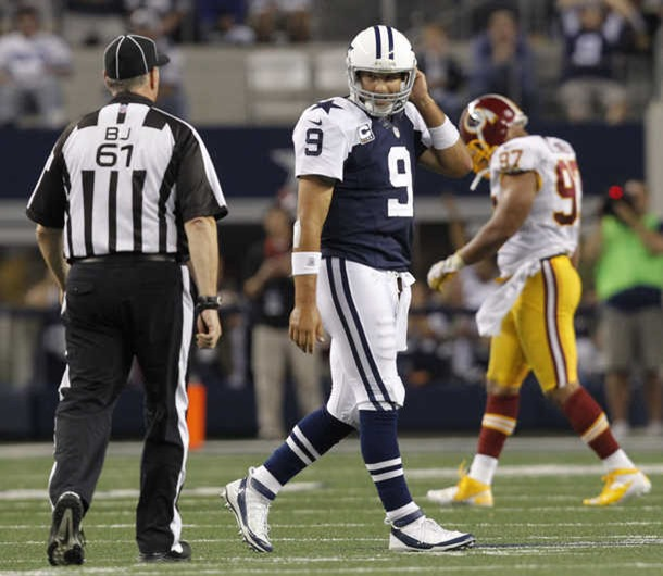 Dallas Cowboys quarterback Tony Romo (9) walks after the field after being intercepted 2012 - The Boys Are Back blog