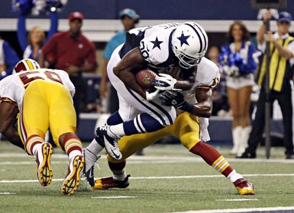 Dallas Cowboys running back Felix Jones (28) jumps past Washington Redskins free safety Madieu Williams - The Boys Are Back blog