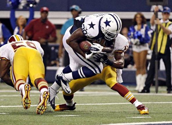 Dallas Cowboys running back Felix Jones (28) jumps past Washington Redskins free safety Madieu Williams - The Boys Are Back blog