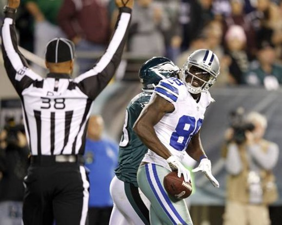 Dallas Cowboys wide receiver Dez Bryant (88) celebrates after back judge Greg Yette (38) signals a touchdown - The Boys Are Back blog