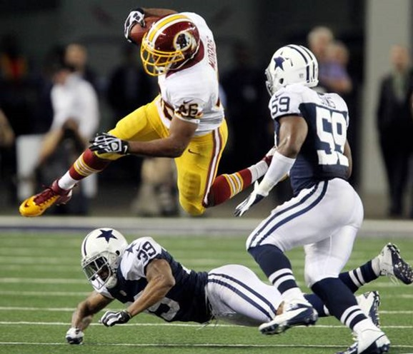 Washington running back Alfred Morris (46) hurdles Dallas defender Brandon Carr - The Boys Are Back blog