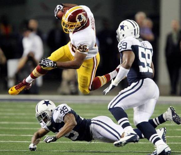 Washington running back Alfred Morris (46) hurdles Dallas defender Brandon Carr - The Boys Are Back blog