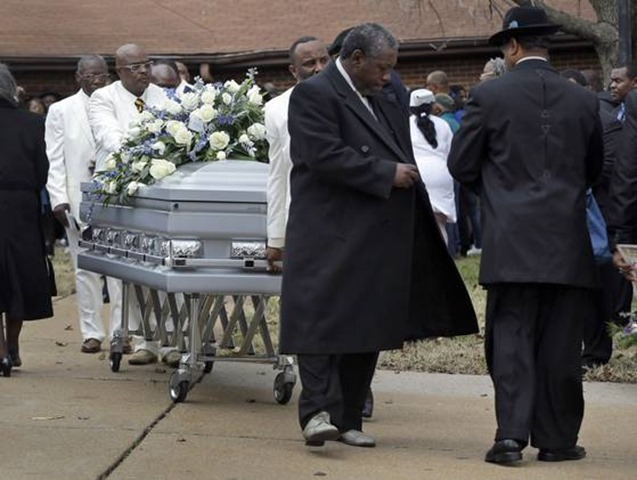 A casket containing the body of Jerry Brown is wheeled out of Hopewell Missionary Baptist Church during his funeral Saturday in St. Louis - The Boys Are Back blog
