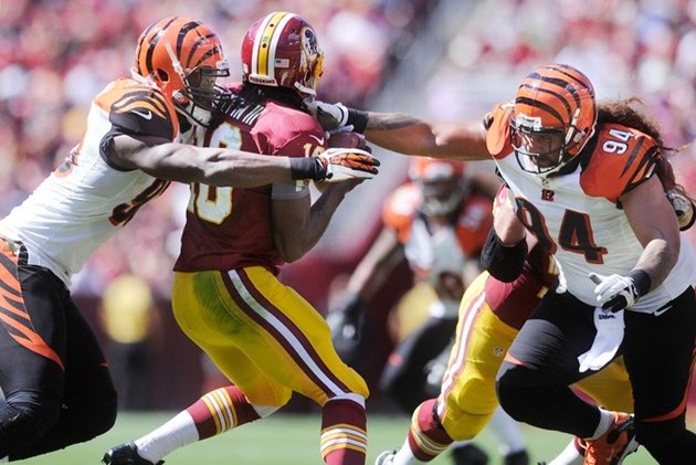 Cincinnati Bengals defensive end Michael Johnson (L) sacks Washington Redskins quarterback Robert Griffin III - The Boys Are Back blog