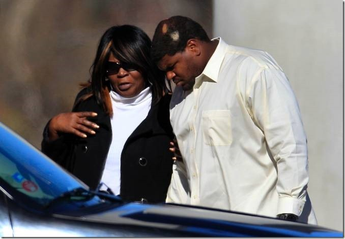 Dallas Cowboys football player Josh Brent, right, arrives embracing at a memorial service for teammate Jerry Brown - The Boys Are Back blog