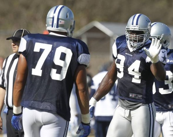 Dallas Cowboys nose tackle Ben Bass (79) gets some direction from DeMarcus Ware - The Boys Are Back blog