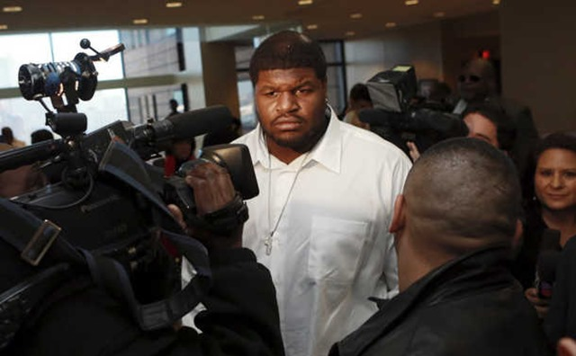 Dallas Cowboys nose tackle Josh Brent, center, is surrounded by media after leaving court Tuesday, Dec. 18, 2012 in Dallas - The Boys Are Back blog