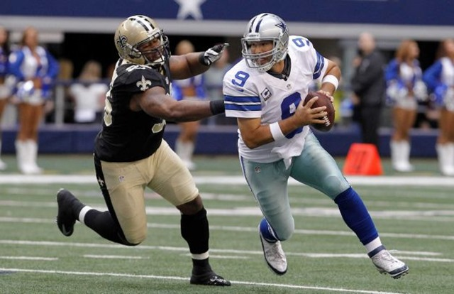 Dallas Cowboys quarterback Tony Romo (9) runs from New Orleans Saints defensive tackle Tom Johnson - The Boys Are Back blog