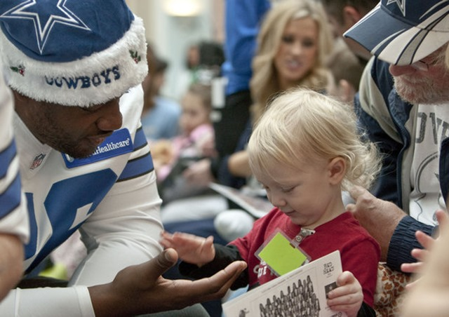 Landry Noble, 2, slaps hands with Dallas Cowboys guard Derrick Dockery (76) at Cook Children's Hospital in Fort Worth - The Boys Are Back blog