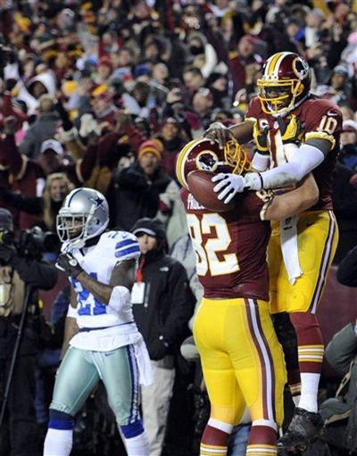 Washington Redskins quarterback Robert Griffin III (10) celebrates his touchdown with tight end Logan Paulsen - The Boys Are Back blog