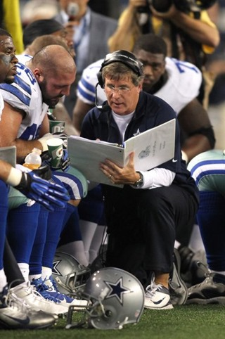 Dec 2, 2012; Arlington, TX, USA; Dallas Cowboys offensive line coach Bill Callahan talks with tackle Doug Free (68) during the game against the Philadelphia Eagles at Cowboys Stadium. The Cowboys beat the Eagles 38-33. Mandatory Credit: Tim Heitman-USA TODAY Sports