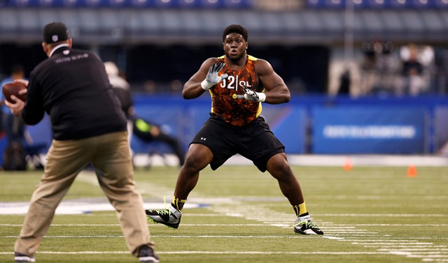 Chance Warmack - Alabama - participates in an offensive line drill during 2013 NFL Combine - Joe Robbins of Getty Images - The Boys Are Back blog 2013