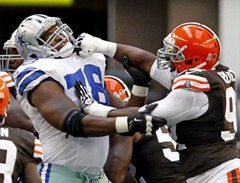 dallas cowboys tackle jermey parnell (78) and cleveland browns defensive end frostee rucker (right) battle in first half - the boys are back blog