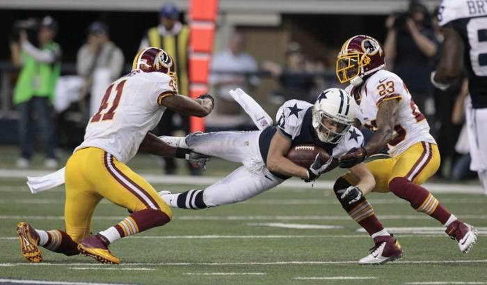 dallas cowboys wide receiver cole beasley (11) dives for yardage after
