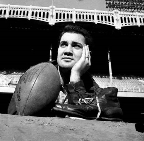 Dec. 27, 1958, file photo, New York Giants place kicker Pat Summerall poses with his shoe and a football during a workout at New York's Yankee Stadium