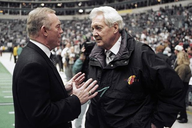Jan. 23, 1994 - Dallas Cowboys owner Jerry Jones talks with CBS commentator Pat Summerall before NFC championship game between Cowboys and San Francisco 49ers