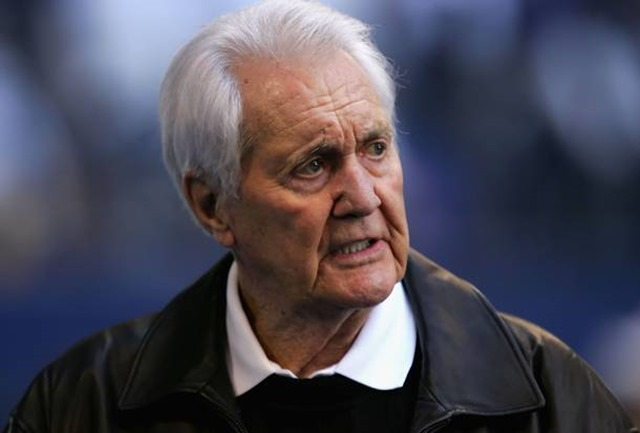 Pat Summerall walks the sidelines during warm ups to the NFC Divisional Playoff game between the Dallas Cowboys and the New York Giants at Texas Stadium on January 13, 2008