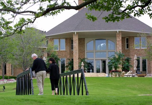 Sportscaster Pat Summerall and his wife, Cheri Summerall, take a walk in their backyard at home in Southlake on April 21, 2002