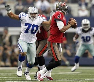 dallas cowboys defensive end tyrone crawford (70) applies pressure to tampa bay buccaneers quarterback josh freeman - the boys are back blog