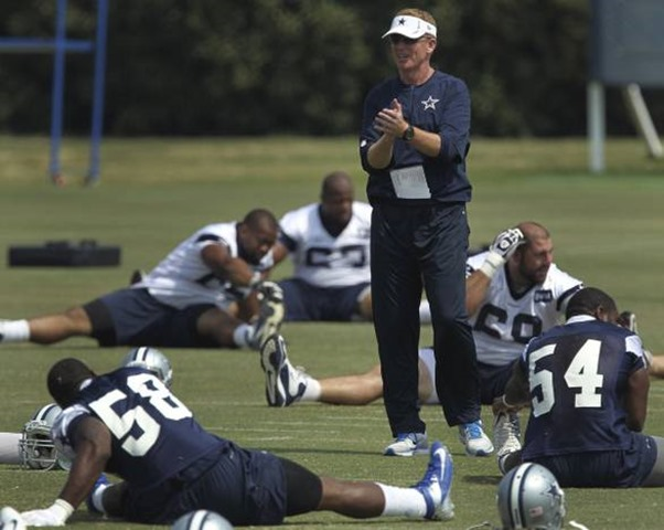 Dallas Cowboys head coach Jason Garrett during stretches at OTA practices at Valley Ranch - The Boys Are Back blog 2012